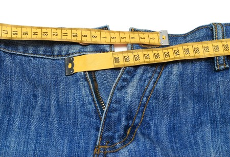 Jeans and tape measure isolated Stock Photo - 6984428