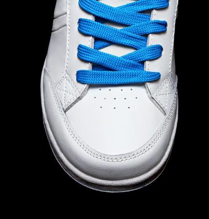 Sport white shoe isolated on black background Stock Photo