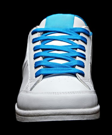 training shoes: Blue sport shoe isolated on black background Stock Photo