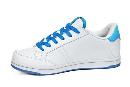 White sport shoe isolated on white background photo
