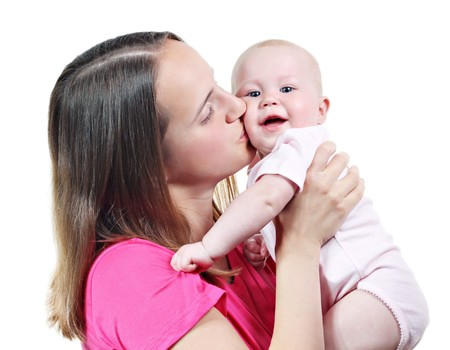 Young mother kiss her baby, isolated on white Stock Photo - 7160355