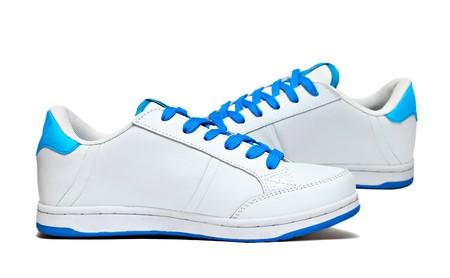White sport shoes isolated on white background photo