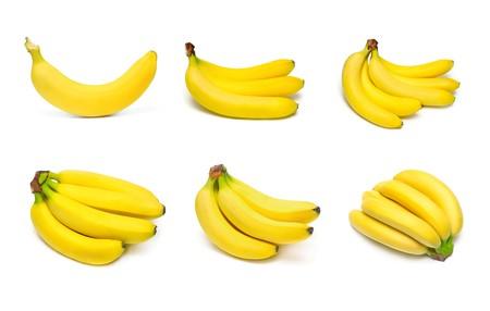 comiendo platano: Bananos maduros establecer aislado sobre fondo blanco  Foto de archivo