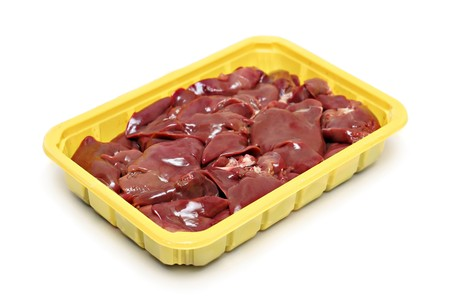 offal: Raw liver in the plastic plate isolated Stock Photo