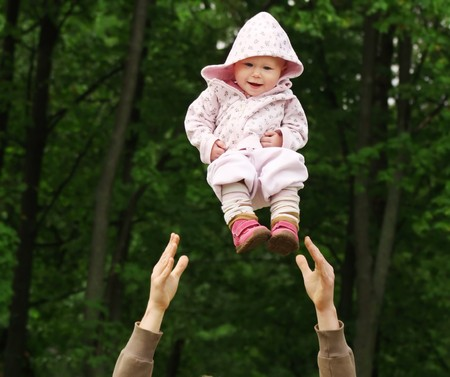 Baby flying in the park photo