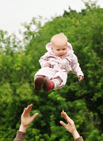 throw up: Baby flying in the sky Stock Photo