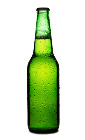 Beer bottle with drops isolated on wgite photo