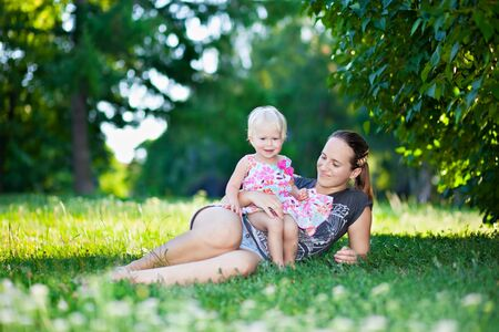 Baby and mother playing in the park photo