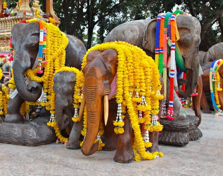 ancient elephant: Group of elephant statues decorated with flowers Stock Photo
