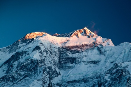 Annapurna in sunrise light, Himalaya, Nepal photo