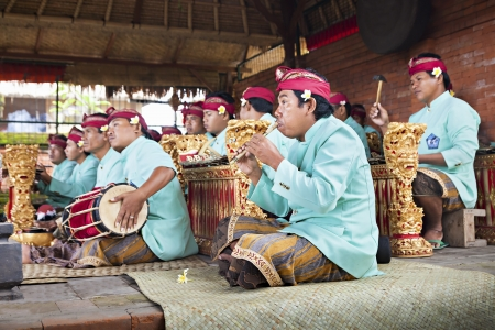 BALI, INDONESIA - APRIL 01: Musicians in the Gamelan troupe play traditional Balinese music to accompany dancers in a Barong Dance show in Ubud village on April 01, 2011 in Bali, Indonesia.