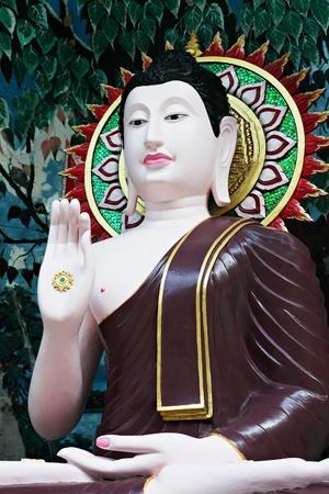 buddha head: Buddha statue on the beauty background Stock Photo