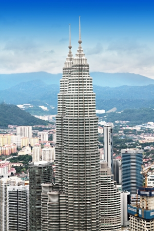KUALA LUMPUR, MALAYSIA - DECEMBER 18: Petronas Twin Towers panorama at morning on December 18, 2010 in Kuala Lumpur, Malaysia. Petronas Twin Towers were the tallest buildings (452 m) in the world from 1998 to 2004.