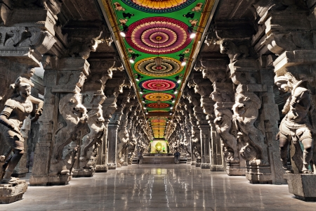 monument in india: Inside of Meenakshi hindu temple in Madurai, Tamil Nadu, South India. Religious hall of thousands of columns