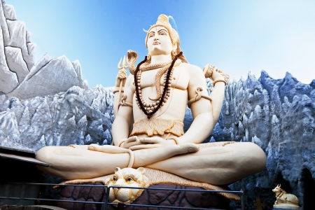 BANGALORE, INDIA - MARCH 27: Big Lord Shiva statue sitting in lotus with trident on March 27, 2012 in Bangalore, India. This Shiva Statue is highest in the world - 65 feet high. Stock Photo - 17839175