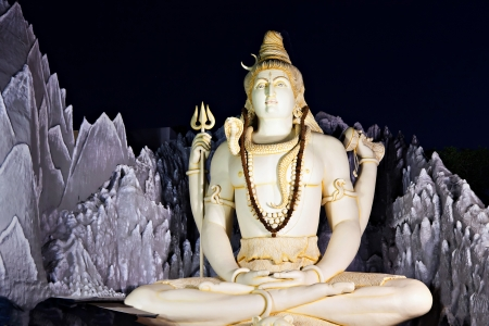 BANGALORE, INDIA - MARCH 27: Big Lord Shiva statue sitting in lotus with trident on March 27, 2012 in Bangalore, India. This Shiva Statue is highest in the world - 65 feet high. Stock Photo - 17839159