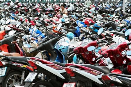 PHUKET, THAILAND - NOVEMBER 20: Many motorbikikes at the parking near big store on November, 20, 2010, Phuket, Thailand. Motorbike is a most popular transport in Thailand.