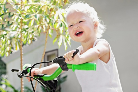 Baby riding on the bicycle photo