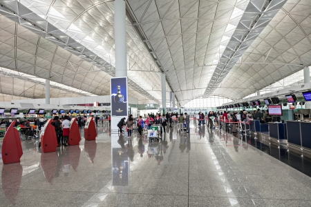 HONG KONG, CHINA - FEBRUARY 21: Passengers in the airport main lobby of Hong Kong airport on February, 21, 2013 in Hong Kong, China. Hong Kong airport handles more than 55 million passengers per year Stock Photo - 22053343