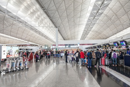 HONG KONG, CHINA - FEBRUARY 21: Passengers in the airport main lobby of Hong Kong airport on February, 21, 2013 in Hong Kong, China. Hong Kong airport handles more than 55 million passengers per year Stock Photo - 22053344