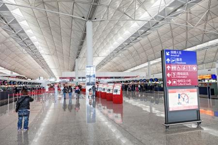 HONG KONG, CHINA - FEBRUARY 21: Passengers in the airport main lobby of Hong Kong airport on February, 21, 2013 in Hong Kong, China. Hong Kong airport handles more than 55 million passengers per year Stock Photo - 22053345