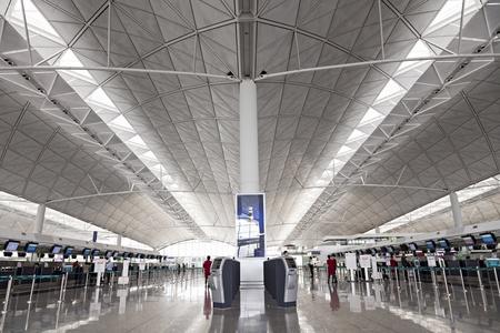 HONG KONG, CHINA - FEBRUARY 21: Passengers in the airport main lobby on February 21, 2013 in Hong Kong, China. The Hong Kong airport handles more than 70 million passengers per year. Stock Photo - 22053349