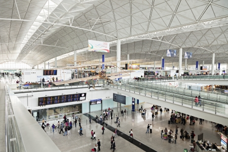 HONG KONG, CHINA - FEBRUARY 21: Passengers in the airport main lobby on February 21, 2013 in Hong Kong, China. The Hong Kong airport handles more than 70 million passengers per year. Stock Photo - 22053350