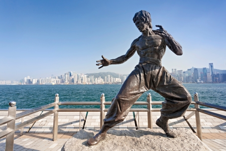 famous industries: HONG KONG, CHINA - FEBRUARY 21: Bruce Lee statue at the Avenue of Stars on February, 21, 2013, Hong Kong, China. Editorial