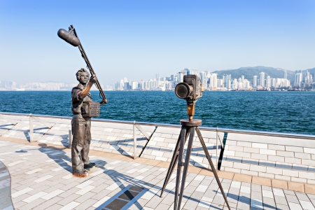 HONG KONG, CHINA - FEBRUARY 21: Statues and skyline on Avenue of Stars on February 21, 2013 in Hong Kong, China. The promenade honours celebrities of the Hong Kong film industry as the famous city attraction.