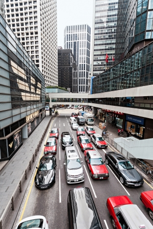 taxicabs: HONG KONG - February 21: Traffic jam on one the highways on February 21, 2013 in Hong Kong. Most of the vehicles on Hong Kongs streets are taxis.