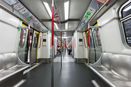 HONG KONG - FEBRUARY 22: Subway train interior on FEBRUARY 22, 2012 in Hong Kong. Over 90% daily travelers use public transport. Its the highest rank in the world.