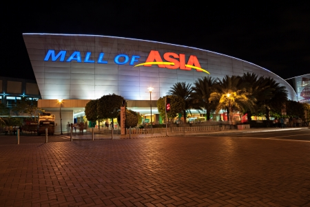 approximate: MANILA, PHILIPPINES - FEBRUARY 23: SM Mall of Asia (MOA) is a 2nd largest mall in the Philippines on February 23, 2013 in Manila, Philippines. It has a land area of 42 hectares and has gross floor area of an approximate 390193 meters Editorial