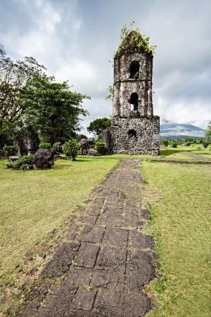 mayon: Cagsawa Ruins are the remnants of an 18th century Franciscan church, built in 1724 and destroyed by the 1814 eruption of the Mayon Volcano. Stock Photo