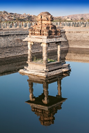 karnataka culture: Ruined pond with water, Hampi, India