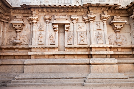 Hindu temple wall with ornate carving, Asia photo