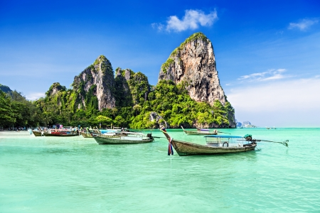 beautiful scenery: Longtale boats at the beautiful beach, Thailand Stock Photo