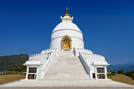 POKHARA, NEPAL - MAY 12: World Peace Pagoda on May 12, 2012, Pokhara, Nepal.  Designed to help unite people their search for world peace. Most pagodas built since World War II under the guidance of Nichidatsu Fuji, a Buddhist monk from Japan.
