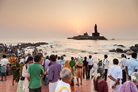KANYAKUMARI, INDIA - MARCH 21: Many piligrims at the sunrise near Vivekananda Rock Memorial and Thiruvalluvar Statue on March 21, 2012, Kanyakumari, India.