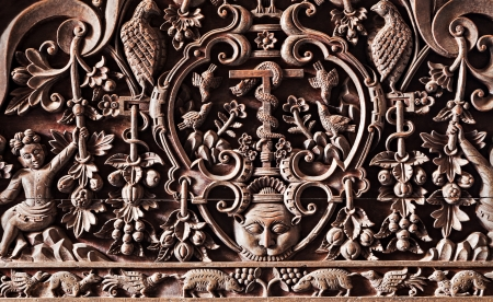 Sophisticated wooden carving on the hindu temple photo