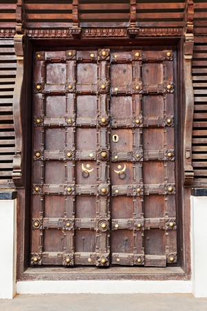 Door with ornament on the hindu temple photo