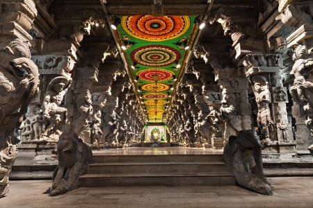 Inside of Meenakshi hindu temple in Madurai, Tamil Nadu, South India. Religious hall of thousands of columns  photo