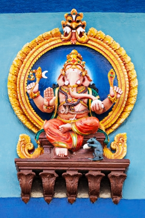 Color Ganesha statue on the temple, India photo