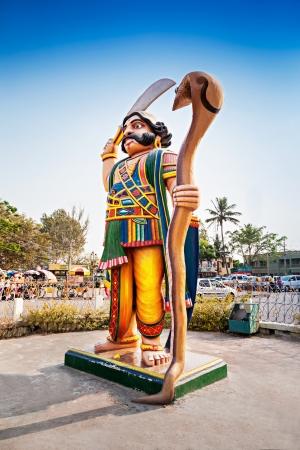mahishasura: MYSORE, INDIA - MARCH 25: Mahishasura demon statue on Chamundi hill on March 25, 2012 in Mysore, India. Its the iconic image in Mysore tourism.