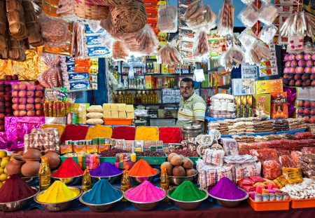 DELHI, INDIA - MARCH 26: Indian shop on March 26, 2012, Delhi, India. Small shops like this are the most common in poor region of Delhi. Tourists can see the color of India in them.