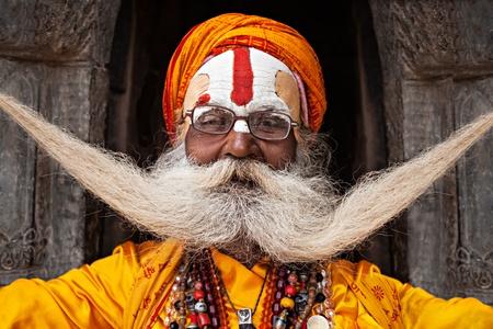 KATHMANDU - APRIL 15: Sadhu at Pashupatinath Temple in Kathmandu, Nepal on April 15, 2012. Sadhus are holy men who have chosen to live an ascetic life and focus on the spiritual practice of Hinduism