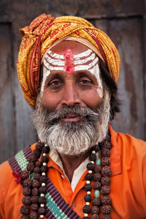 KATHMANDU - APRIL 15: Sadhu at Pashupatinath Temple in Kathmandu, Nepal on April 15, 2012. Sadhus are holy men who have chosen to live an ascetic life and focus on the spiritual practice of Hinduism Stock Photo - 22053482