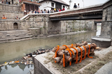 KATHMANDU - APRIL 15: Cremation ceremony along the holy Bagmati River at Pashupatinath Temple complex, April 15, 2012 in Kathmandu, Nepal. This is the most sacred place to all Hindus in Nepal.