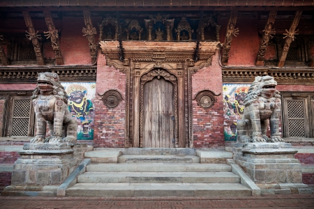 KATMANDU, NEPAL - APRIL 16: Stone statues near the temple on Durbar square on April 16, 2012, Katmandu, Nepal.