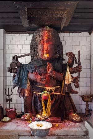 KATMANDU, NEPAL - APRIL 16: Terrible religious idol inside hindu temple at Durbar square on April 16, 2012, Katmandu, Nepal. photo