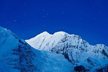 Gangapurna and Annapurna mountains on the blue sky with stars, Himalaya, Nepal Stock Photo - 22100689